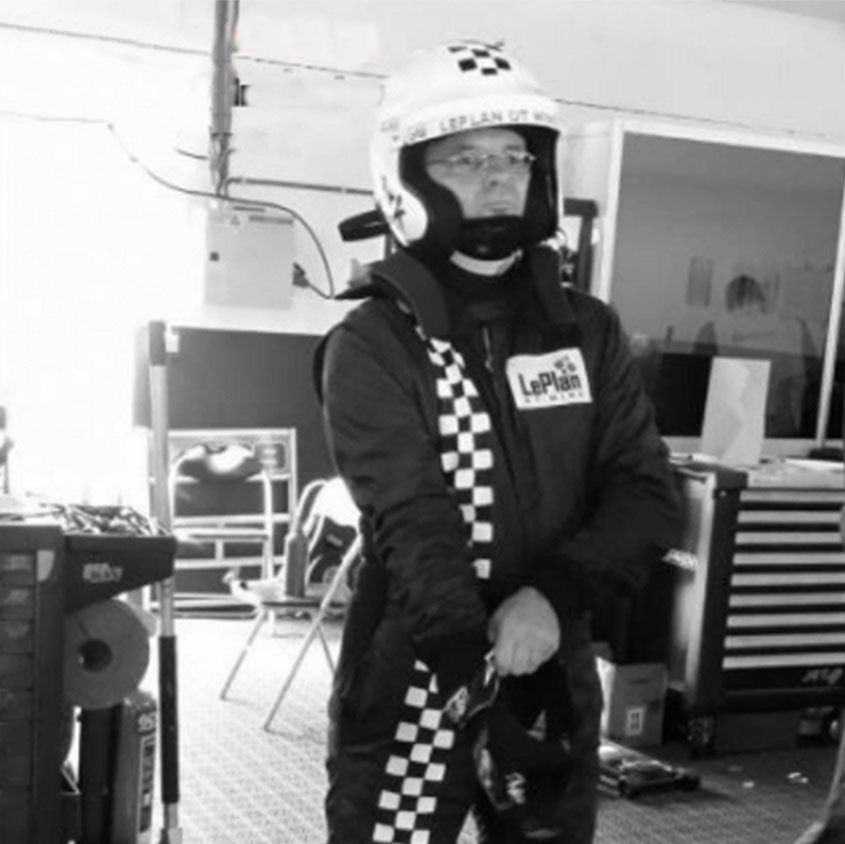 Dirk Vermeersch racing driver with a racing suit and a helmet picture