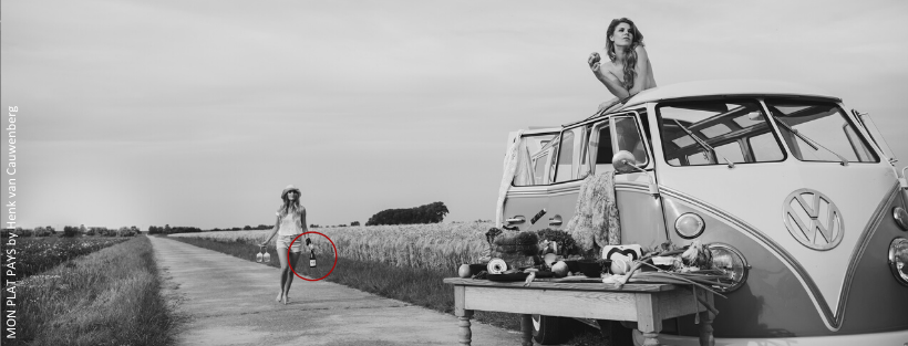 One girl walking with a bottle of GT-Grenache towards a Vintage Volkswagen Type 2 Combi