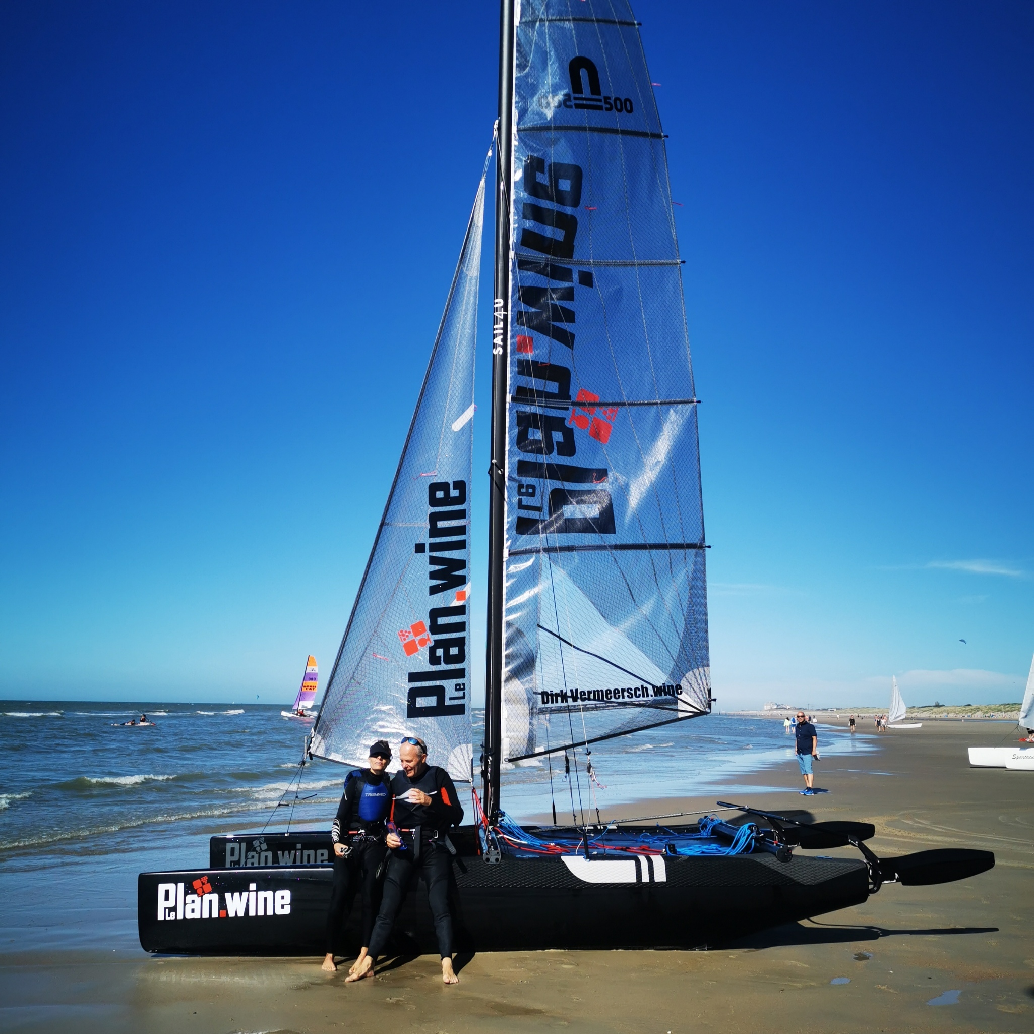 Sailling boat sponsored by LePlan-Vermeersch at the beach